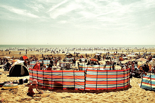 Windbreaks and umbrellas on a British beach
